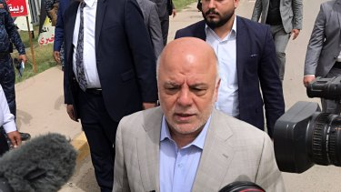 Iraq Prime Minister Haider al-Abadi speaks to reporters after casting his ballot in the country's parliamentary elections in Baghdad on  Saturday.