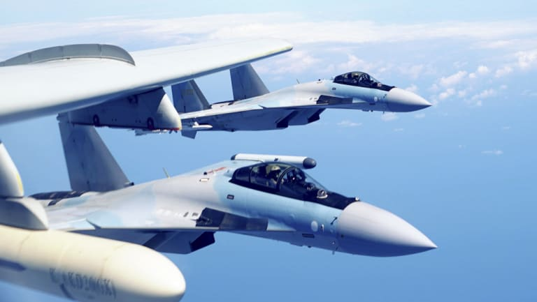 Two Su-35 fighter jets and a H-6K bomber from China's People's Liberation Army air force fly in formation during patrol that included the Luzon Straits also known as Bashi Straits near Taiwan on an earlier excursion this month.