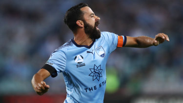 Another one: Alex Brosque roars in celebration after scoring his sixth Sydney derby goal on Saturday night.