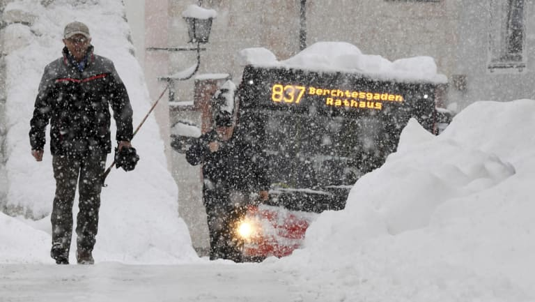 Large parts of southern Germany and Austria have been paralysed by heavy snow.