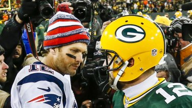 New England Patriots quarterback Tom Brady (left) and Green Bay Packers quarterback Aaron Rodgers after their lone matchup in 2014.