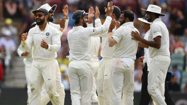 Halcyon days: India enjoy claiming another Australian scalp on day four in Adelaide.