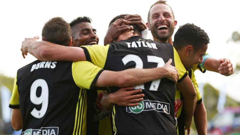 Heading home: Steven Taylor of the Phoenix celebrates with teammates after scoring Wellington's third.