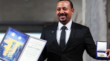 Ethiopia's Prime Minister Abiy Ahmed poses for the media after receiving the Nobel Peace Prize during the award ceremony in Oslo City Hall, Norway, last year.