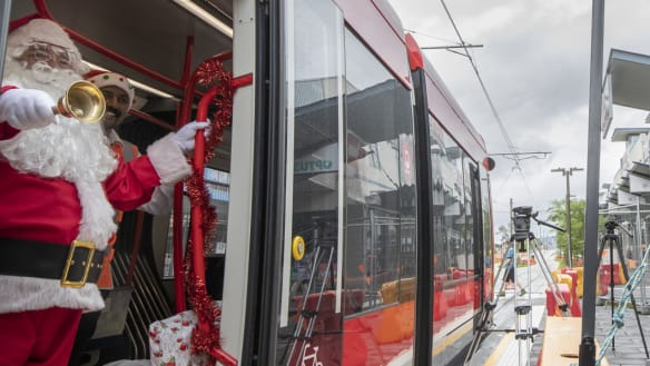 Santa enjoys a 'smooth' ride on the tram to deliver presents