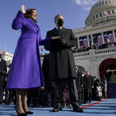Kamala Harris takes the oath of office on January 20 with her husband, Doug Emhoff, by her side.