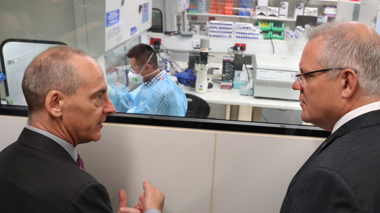 Dr Mike Catton explains to Prime Minister Scott Morrison  how the virus was grown.