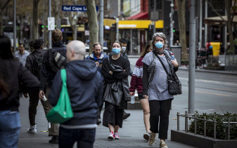 Melbourne residents wear masks before they became mandatory in July.