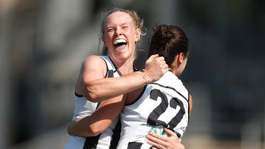 Sarah D'Arcy and Sophie Casey celebrate a goal.