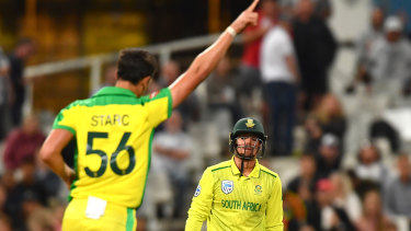Mitchell Starc celebrates the dismissal of South African captain Quinton de Kock at Cape Town.