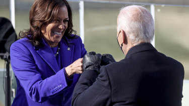 US Vice President Kamala Harris bumps fists with President Joe Biden after she was sworn in during the inauguration in January.