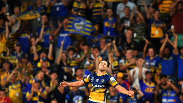 Home and hosed: Mitchell Moses celebrates a try as the Eels christen Bankwest Stadium in style.