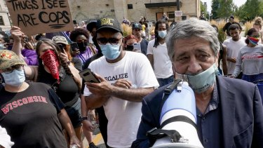 Kenosha Mayor John Antaramian tries to speak to protesters in Kenosha, Wisconsin.