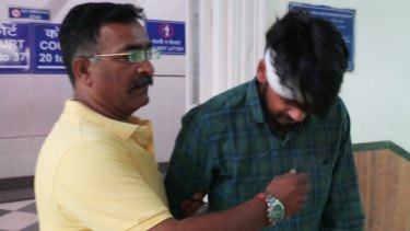 Hit-and-run driver Puneet Puneet (right) leaving court with his uncle in Dehli on Friday.