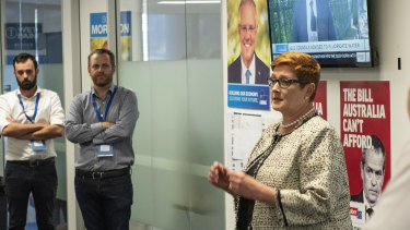 Liberal campaign deputy director Isaac Levido, left, watches as Liberal MP Marise Payne speaks.