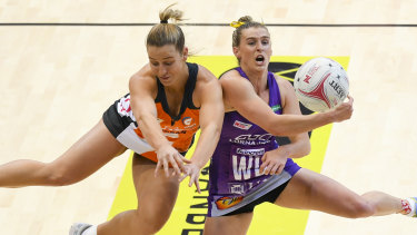 Giant Jamie-Lee Price (left) fights for the ball with Gabi Simpson of the Firebirds on Sunday.