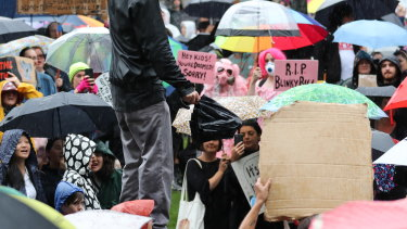 Protesters in Melbourne were greeted by rain.