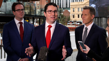 Labor's candidate for Perth, Patrick Gorman at a press conference as Labor's candidate for Fremantle, Josh Wilson (right), and Federal Member for Burt, Matt Keogh, look on.