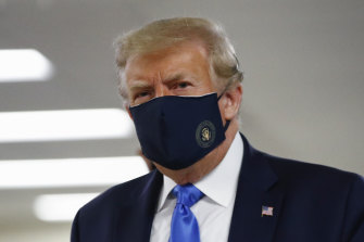 Donald Trump during a rare public appearance in a mask.