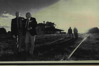 Albert Meyer and Martin Sanders reminisce about old times during a Dunera Boys reunion at Hay Railway Station in 1990. Jimmy King and Walter Kaufmann in the background.