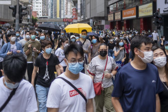 Demonstrators wearing protective masks march during a protest against a planned national security law in the Wan Chai district in Hong Kong, China, on Sunday, May 24.