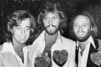 The Bee Gees, from left, Robin, Barry and Maurice Gibb, attend a party following the Hollywood premiere of Sgt. Pepper's Lonely Hearts Club Band in a still from the documentary The Bee Gees: How Can You Mend a Broken Heart?