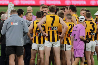 Alastair Clarkson addresses the Hawks players at three-quarter-time on Friday night.