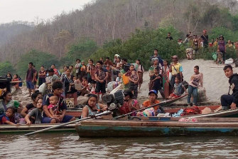 People on the banks of the Salween river crossed into Thailand but were turned back.