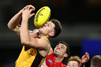 Hawthorn's Jacob Koschitzke attempts a mark against the Swans on Friday night.