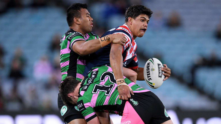 Hard to stop: Man of the moment Latrell Mitchell of the Roosters attempts an offload.