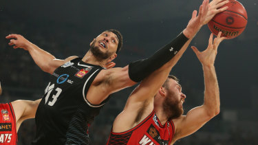 Melbourne United's Josh Boone takes on Perth Wildcat Nick Kay in game 4 of the grand final series.