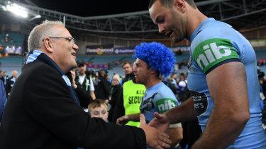 Prime Minister Scott Morrison congratulates Boyd Cordner after NSW secured back-to-back Origin triumphs.