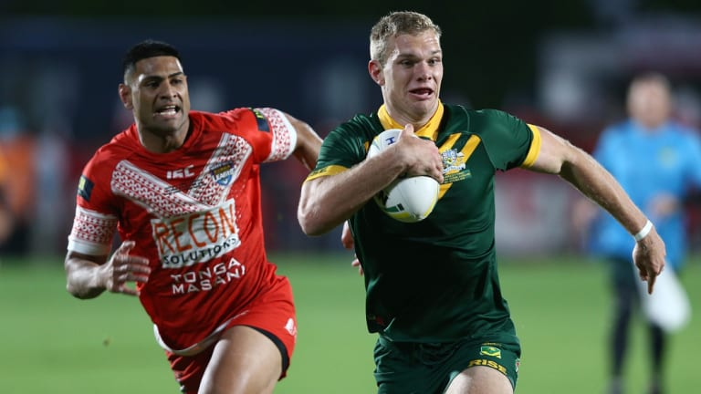 Centre of the action: Tom Trbojevic streaks away from Tonga's Daniel Tupou on Saturday night.