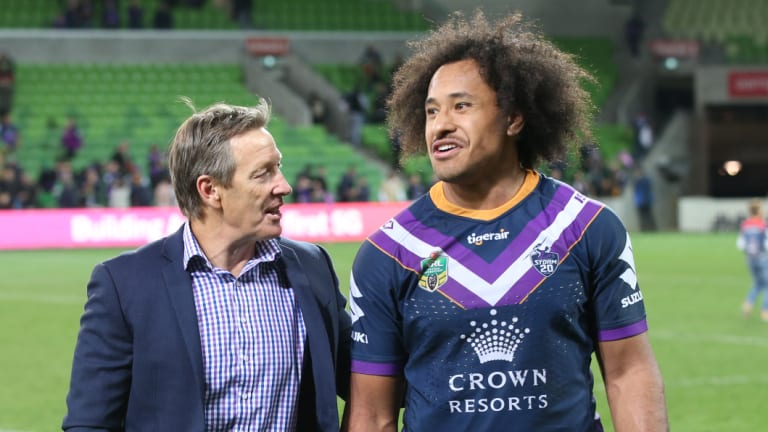 Hair apparent: Felise Kaufusi with Craig Bellamy after beating Souths in the first week of the finals.