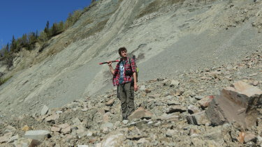 Mr Bobrovskiy searches for fossils in the Zimnie Gory locality, Russia.