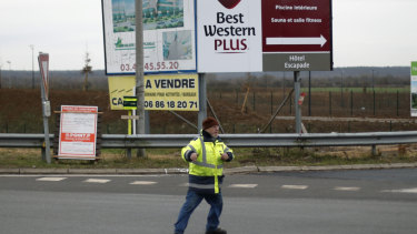 Yellow vest protestrr Michel, no family name available, directs the traffic on a roundabout near Senlis, north of Paris.