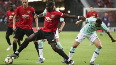 Still a Red Devil: Manchester United's Paul Pogba in action against Inter Milan in Singapore.