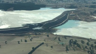 An aerial image showing the collapsed section of the tailings dam.