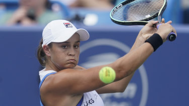 Ashleigh Barty returns a shot to Jil Teichmann in the final of the Western & Southern Open.
