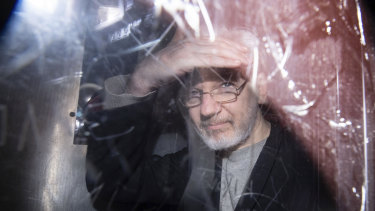 Wikileaks founder Julian Assange leaves in a prison van after appearing in court in January.
