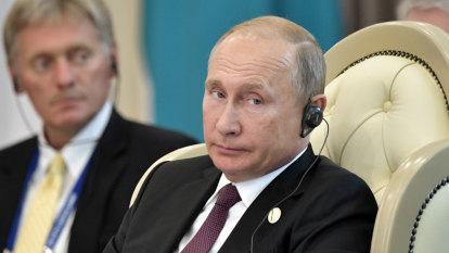 Kremlin plays down reports of US spy in Vladimir Putin's office