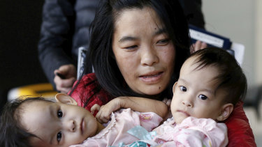Conjoined twins Nima and Dawa Pelden arrive in Melbourne from Bhutan with their mother.