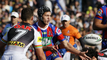 Pin-up: Kalyn Ponga directs traffic after switching to five-eighth for the Knights