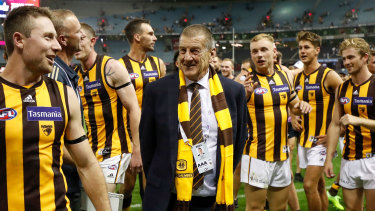 Jeff Kennett with Hawthorn players after their one point win over Essendon earlier in the season.