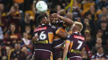 Barnstorming: Broncos forward Payne Haas celebrates his try with teammates.