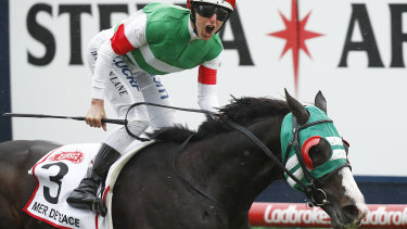 Damian Lane gives a yell as he takes the Caulfield Cup on Mer De Glace.