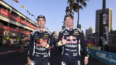 Jamie Whincup and Craig Lowndes celebrate their victory on Saturday.