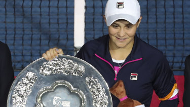 Silver service: Ash Barty poses with her runners-up trophy.
