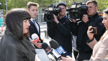 Raelene Castle is grilled by the media following the Folau settlement.