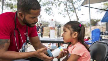 Dr Elisondo treats Estephanie, 4, for asthma.